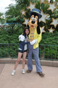 girl posing with Goofy